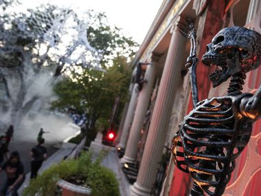 A skelton hangs as part of a display at Six Flags Hallowfest in Arlington on Saturday, Oct. 3.