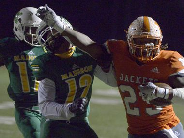 Mineola's Trevion Sneed (23) stiff arms Madison's Jeremiah Horn on his way to a touchdown in the first quarter during a Class 3A Division I area-round playoff game between Madison and Mineola, Friday, Nov. 13, 2020, in Princeton, Texas.