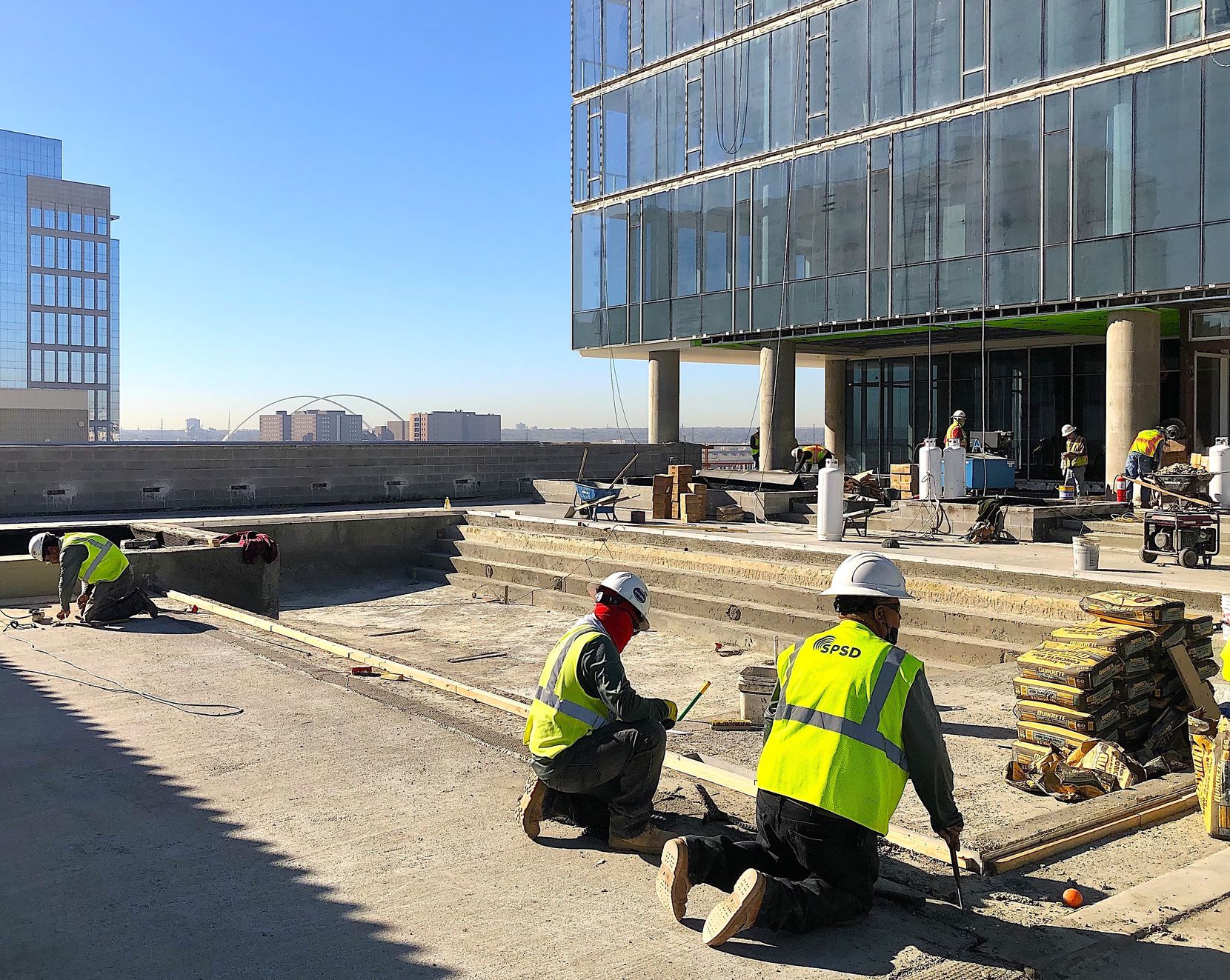 Construction crews work on the pool deck at The Victor apartment tower in Victory Park.