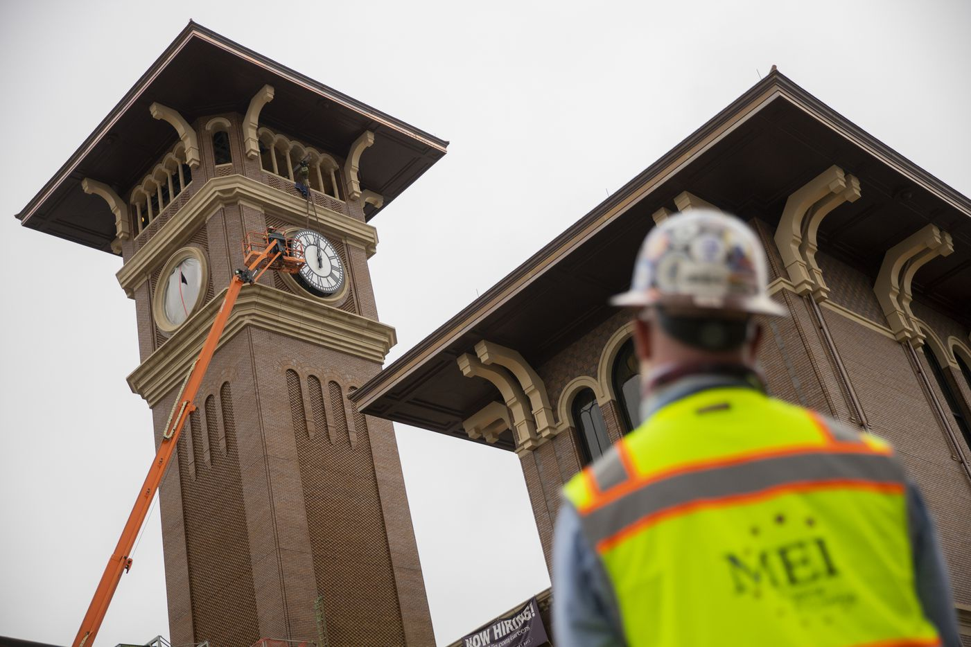 Clint Hoffman, operations manager with MEI Rigging & Crating, watches as his crew works to install a 12-foot glass clock on the Grapevine Main Station's Observation Tower on Sept. 3, 2020 in Grapevine. The clocks designed by Electric Time Company were designed to be compatible with the Texas-Italianate style of the station. (Juan Figueroa/ The Dallas Morning News)