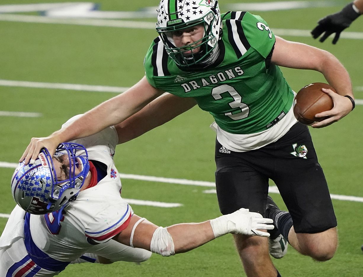 Southlake Carroll quarterback Quinn Ewers (3) pushes past Austin Westlake linebacker Nicholas Morris (13) during the fourth quarter of the Class 6A Division I state football championship game at AT&T Stadium on Saturday, Jan. 16, 2021, in Arlington, Texas. Westlake won the game 52-34.