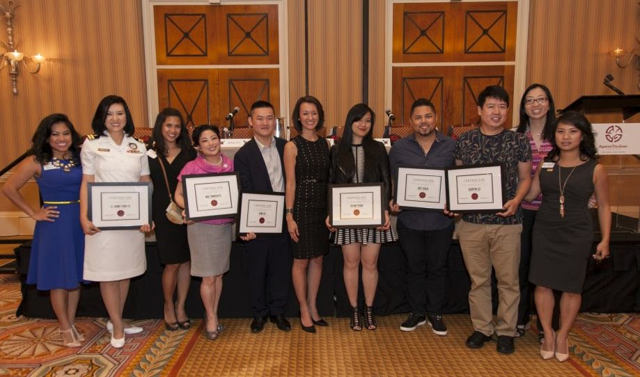Tammy Nguyen Lee (center) presents certificates to the speakers at her fifth annual Groundbreakers Speak: A Conversation with Asian American Movers and Shakers.