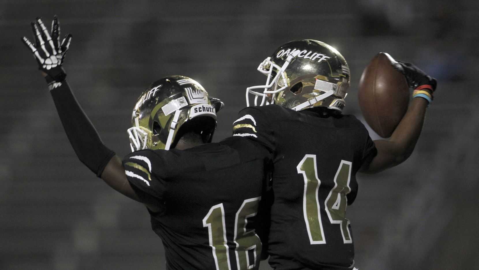 South Oak Cliff receiver Corinthean Coleman (14), right, celebrates with teammate Horace Bradshaw (16) after Coleman scored on a long receiving touchdown during second quarter action against Dallas Hillcrest. The two DISD teams played their District 6-5A Division ll football game at Kincaide Stadium in Dallas on September 17, 2021.