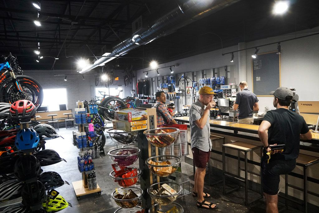 Customers hang out at the coffee bar at the new Velo Cafe in Keller. It's a bike shop that also serves coffee.