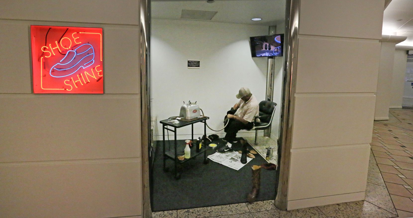 Larry Washington mans his shoe shine shop below the Bank of America Building in the tunnels below street level in downtown Dallas, photographed on Wednesday, May 16, 2018.