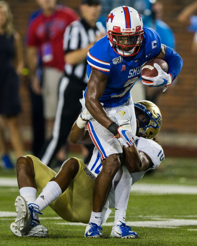 SMU Mustangs wide receiver James Proche (3) is tackled by Tulsa Golden Hurricane safety Manny Bunch (10) during the second quarter of an NCAA football game between Tulsa and SMU on Saturday, October 5, 2019 at Ford Stadium on the SMU campus in Dallas. (Ashley Landis/The Dallas Morning News)