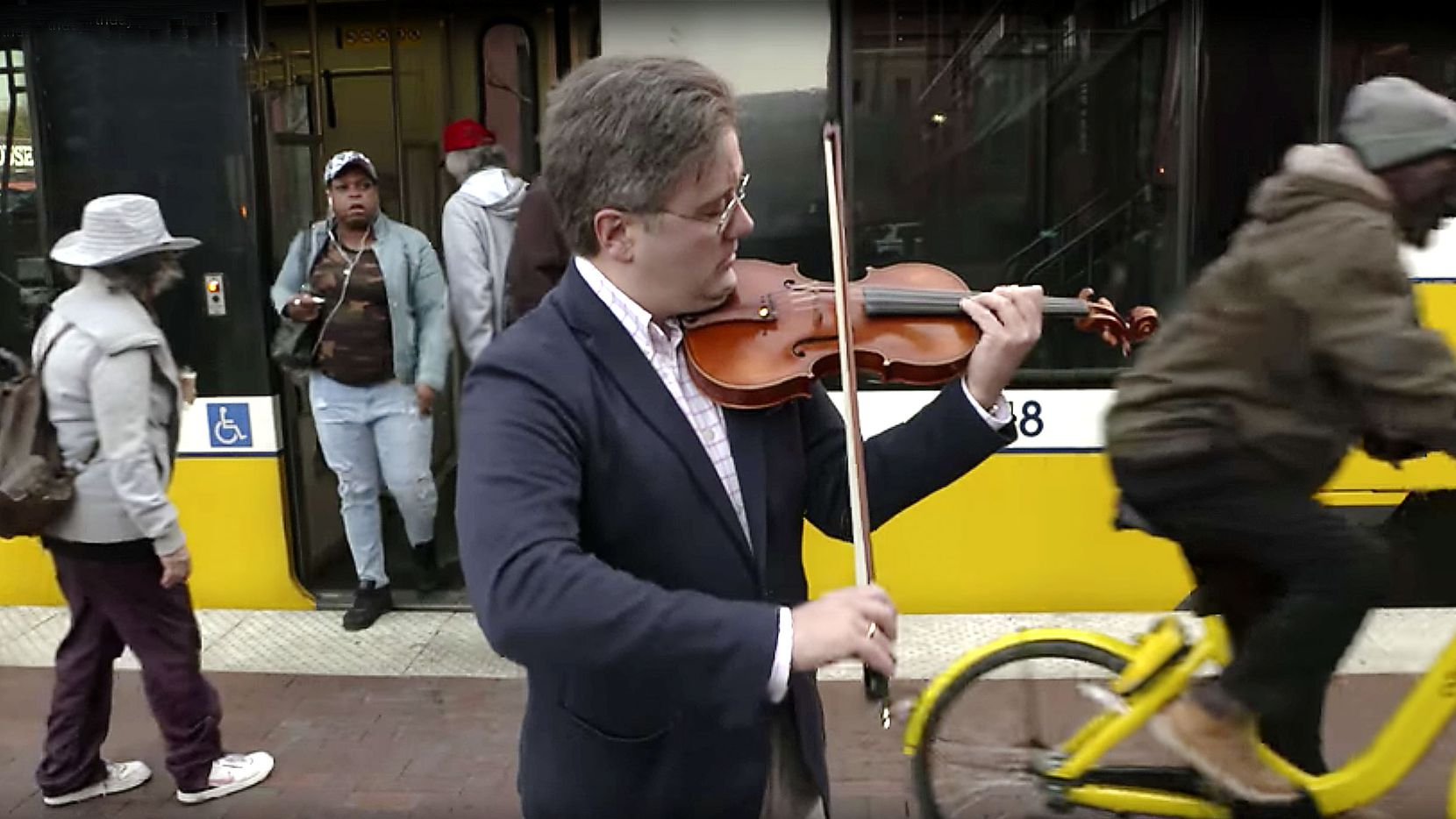 Aaron Boyd, director of chamber music at Southern Methodist University, performs on Johann Sebastian Bach's birthday, Wednesday, March 21, 2018, at a DART train station in downtown Dallas.