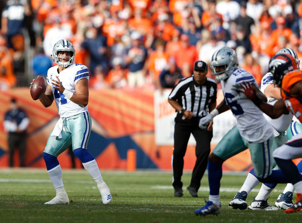 Dallas Cowboys quarterback Dak Prescott (4) looks to pass during the second quarter of play against the Denver Broncos at Sports Authority Field in Denver on Sunday, September 17, 2017. (Vernon Bryant/The Dallas Morning News)