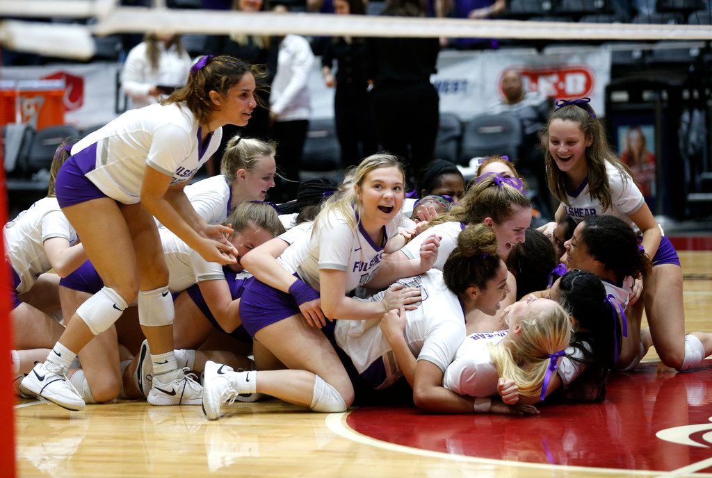 The Lamar Fulshear Chargers dog pile after winning a Class 4A volleyball state semifinal match against Kennedale at the Curtis Culwell Center in Garland, on Thursday, November 21, 2019. Fulshear won three straight sets 25-14, 25-11 and 25-20 to advance to the state final.