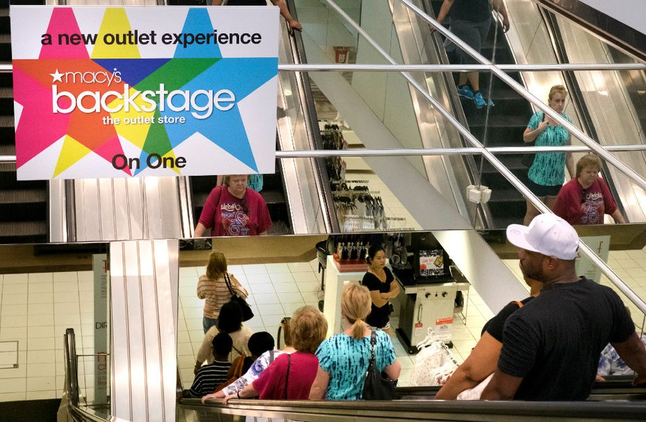 Shoppers fill the escalator during the grand opening of Macy's new Backstage department inside on Saturday, June 17, 2017, at St. Claire Square in Fairview Heights, Ill.