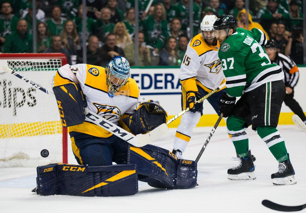 A shot by Dallas Stars center Justin Dowling (37) is deflected by Nashville Predators goaltender Pekka Rinne (35) during the first period of Game 3 of a playoff series between the Dallas Stars and the Nashville Predators on Monday, April 15, 2019 at American Airlines Center in Dallas. (Ashley Landis/The Dallas Morning News)