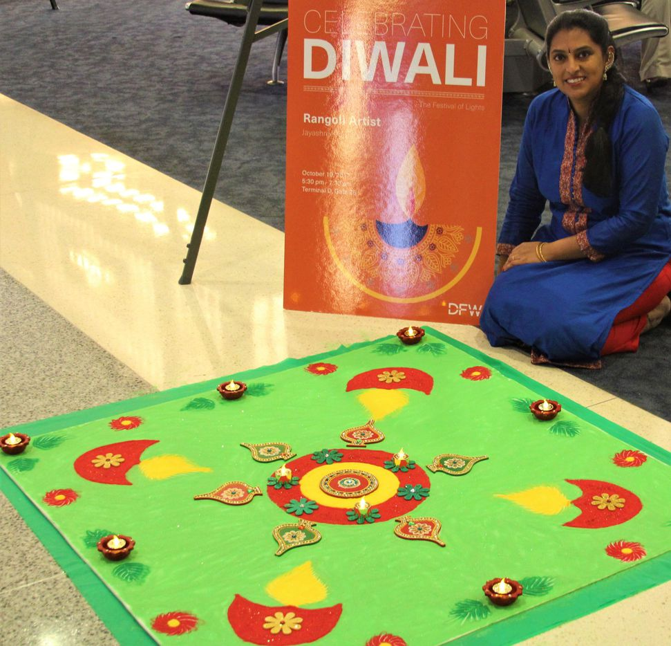 Jayashree Krishnan created a rangoli painting as part of a Diwali celebration Oct. 19 at DFW Airport.