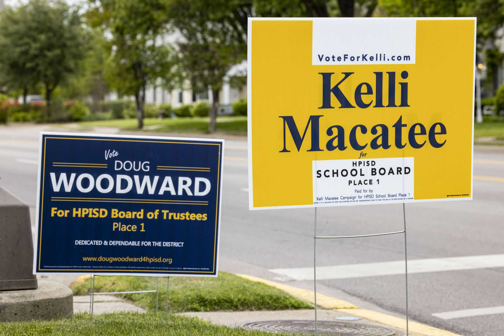 Kellie Macatee and Doug Woodward campaign signs photographed outside of the Highland Park ISD administration building on Wednesday, April 21, 2021, in Dallas. (Juan Figueroa / The Dallas Morning News)