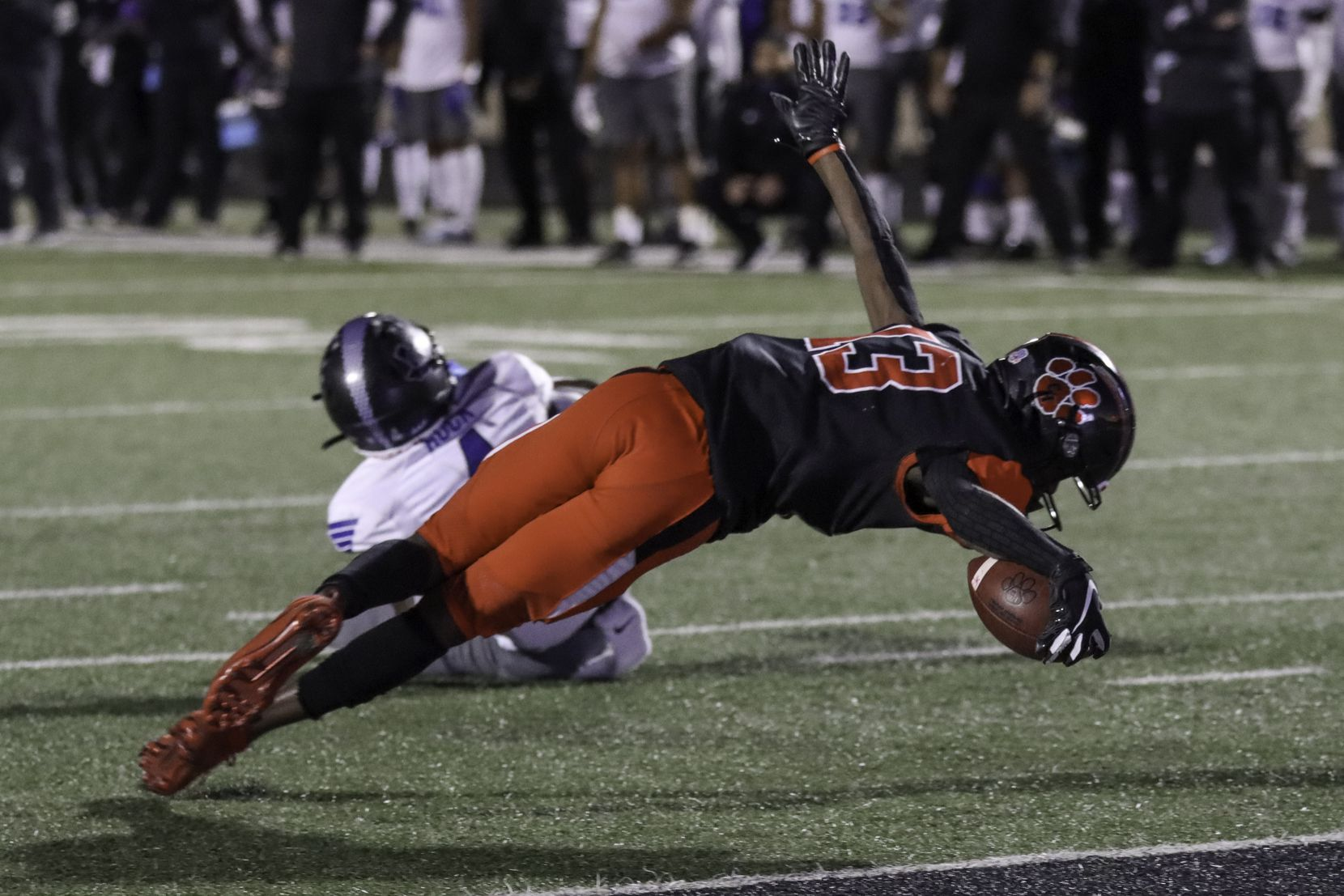Colleyville Heritage wide receiver Leon Covington (13) stretches for a touchdown during the second half against Mansfield Summit at Bearcat Stadium in Aledo, Texas, Saturday, December 26, 2020. (Elias Valverde II / Special Contributor)