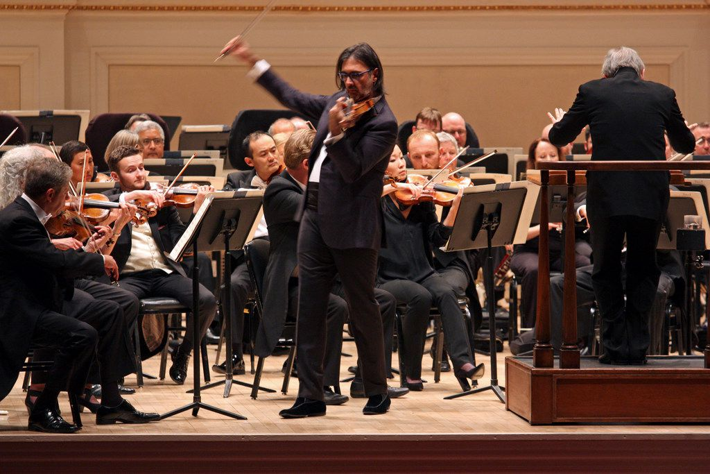 Violinist Leonidas Kavakos performs as soloist at Carnegie Hall, with Michael Tilson Thomas leading the San Francisco Symphony.