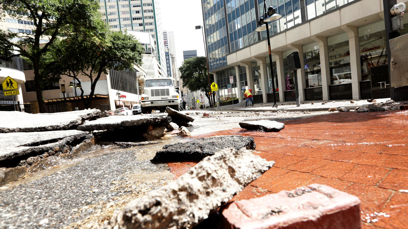The intersection of Akard and Patterson streets sustained significant pavement damage when the water main burst on Tuesday, Aug. 10, 2021.