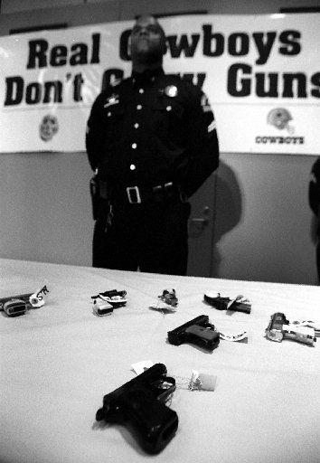 Police spokesman Chris Gilliam participated in a press conference at Children's Medical  Center in 1993. (Staff photo)