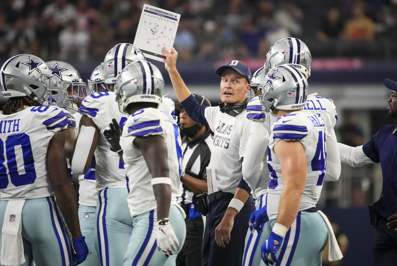 Dallas Cowboys special teams coordinator John Fassel send in a play during the first half of a preseason NFL football game against the Jacksonville Jaguars at AT&T Stadium on Sunday, Aug. 29, 2021, in Arlington. (Smiley N. Pool/The Dallas Morning News)