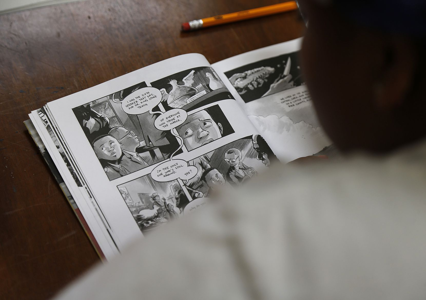 """Youths in the book club are reading """"March: Book One,"""" the bestselling graphic novel by civil rights icon John Lewis and Andrew Aydin."""