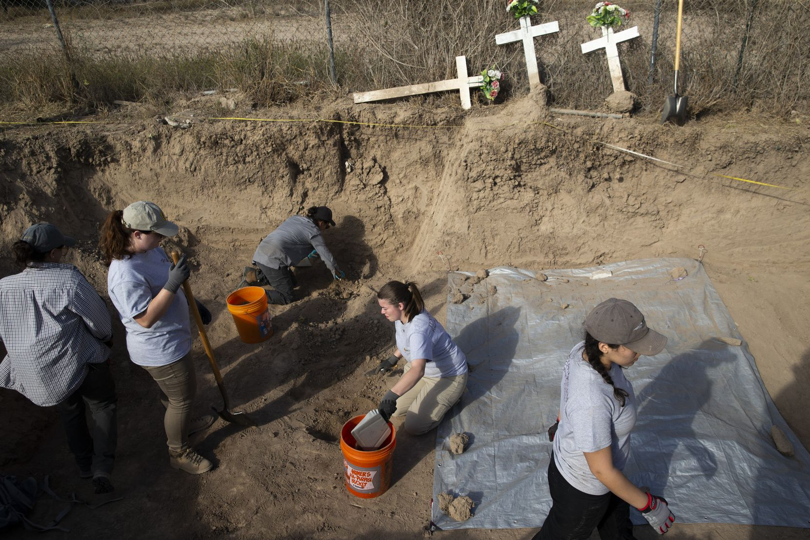 Anthropology students from Texas State University help to exhume the unidentified belongings and bodies of migrants at a cemetery in La Grulla.
