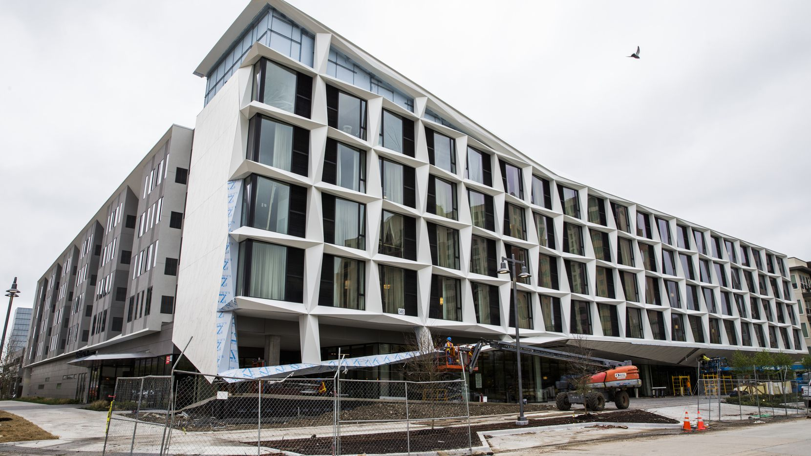 Construction workers put finishing touches on the exterior of the AC Hotel, which is under construction near the Galleria, and was designed by 5G Studio Collaborative.
