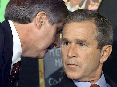 This Sept. 11, 2001, file photo shows President George W. Bush in Sarasota, Fla., being told by White House chief-of-staff Andrew Card of the 9/11 terrorist attacks.