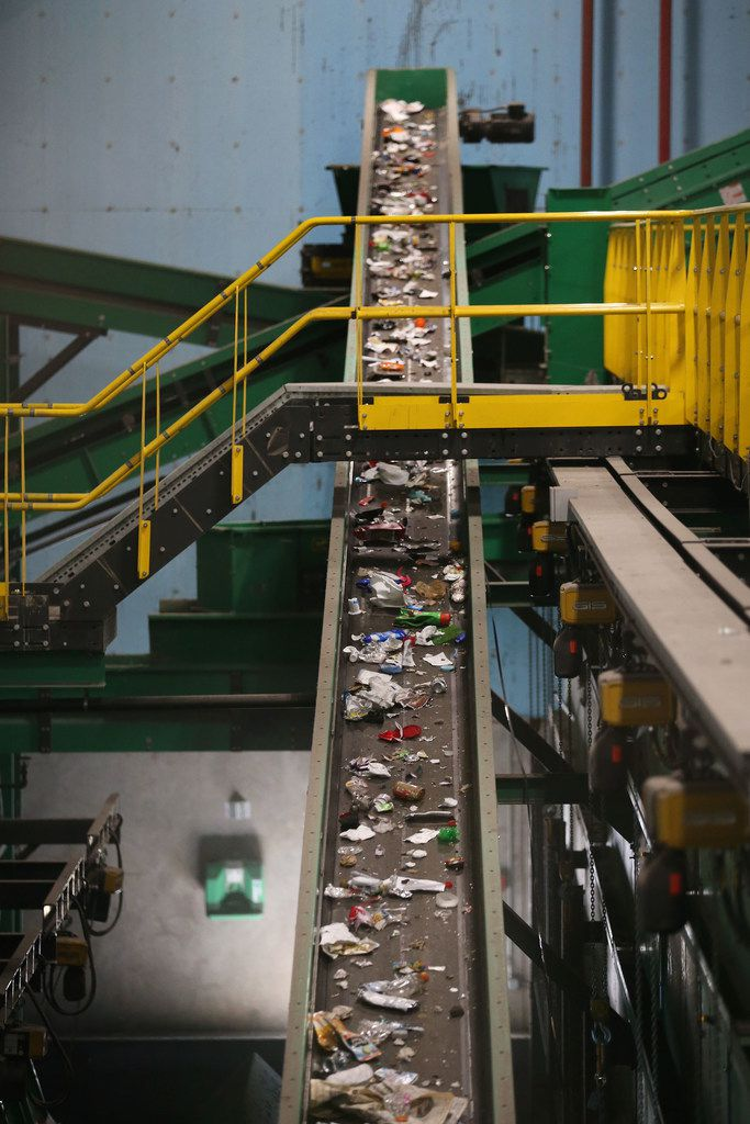 Recycled material moves on a conveyor belt to be sorted at the Dallas recycling facility. China has stopped allowing the import of recyclable goods from many countries including the U.S., and some nations struggle with excess amounts of recyclables and nowhere to send them.