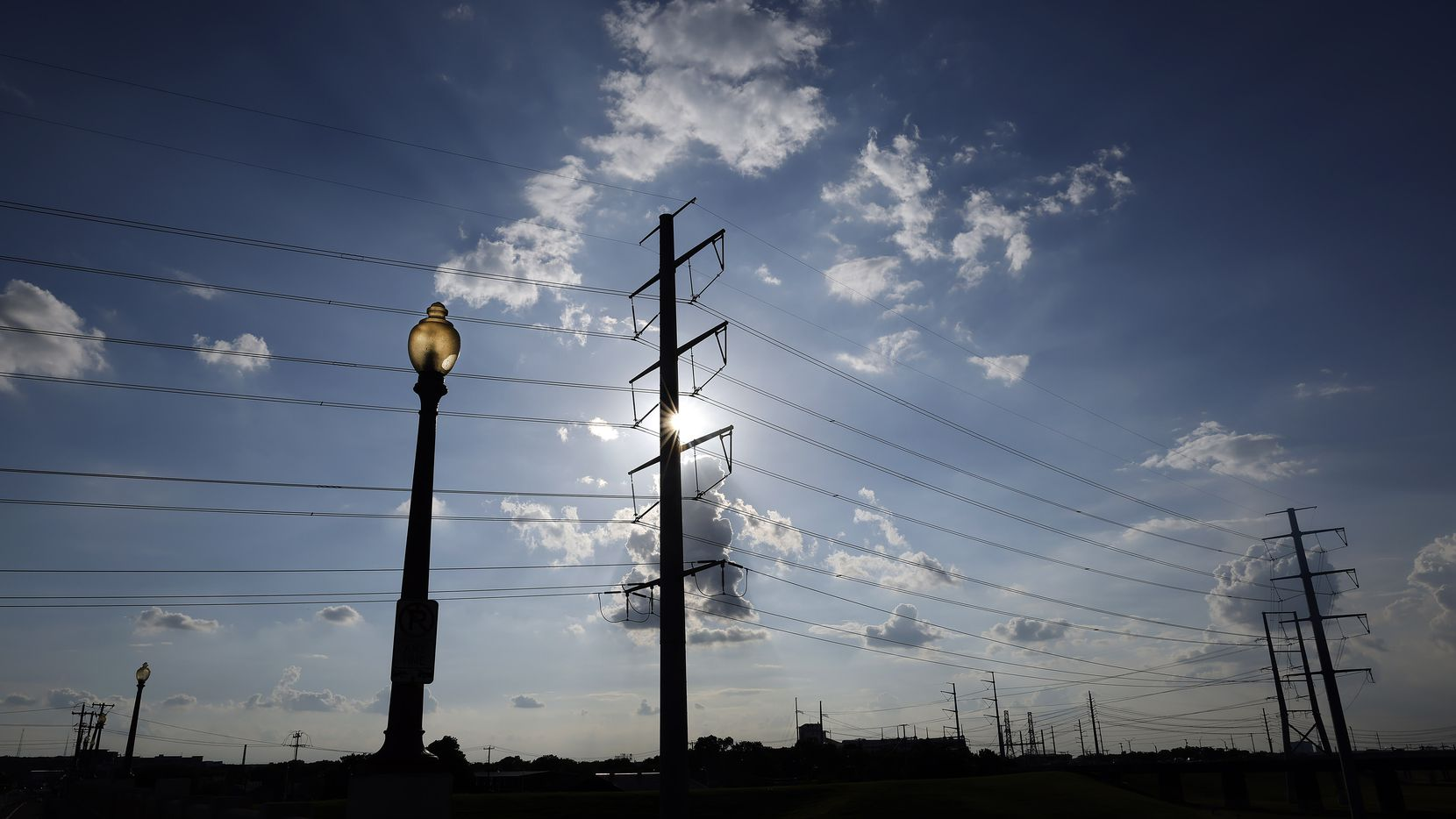 Large electrical transmissions lines are pictured along the Trinity River levee near downtown Dallas, Wednesday, June 30, 2021. (Tom Fox/The Dallas Morning News)