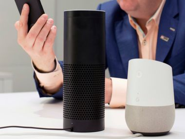 FILE - In this June 14, 2018, photo, an Amazon Echo, center, and a Google Home, right, are displayed in New York. Google contractors are listening to some recordings of people talking to Assistant, either on their phone or through smart speakers such as the Google Home. The company says some of its Dutch language recordings were leaked and that it is investigating. (AP Photo/Mark Lennihan, File)