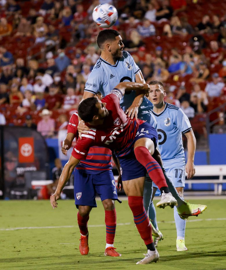 Minnesota United defender Michael Boxall (15) hits the ball over FC Dallas defender Matt Hedges (24) during the first half of a FC Dallas against Minnesota United on Saturday, Oct. 2, 2021, at Toyota Stadium in Frisco. (Juan Figueroa/The Dallas Morning News)