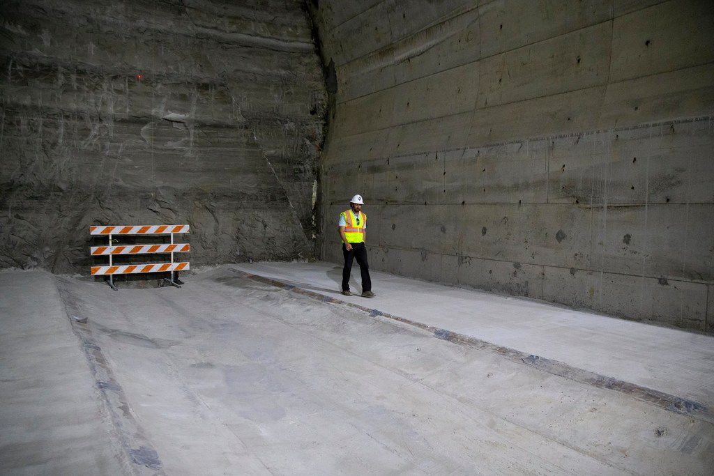 Tim Win walks from one end during a visit into the Mill Creek Drainage Relief Tunnel in Dallas. Once completed, the 5-mile tunnel will sit 70 to 100 feet below ground to provide flood relief.