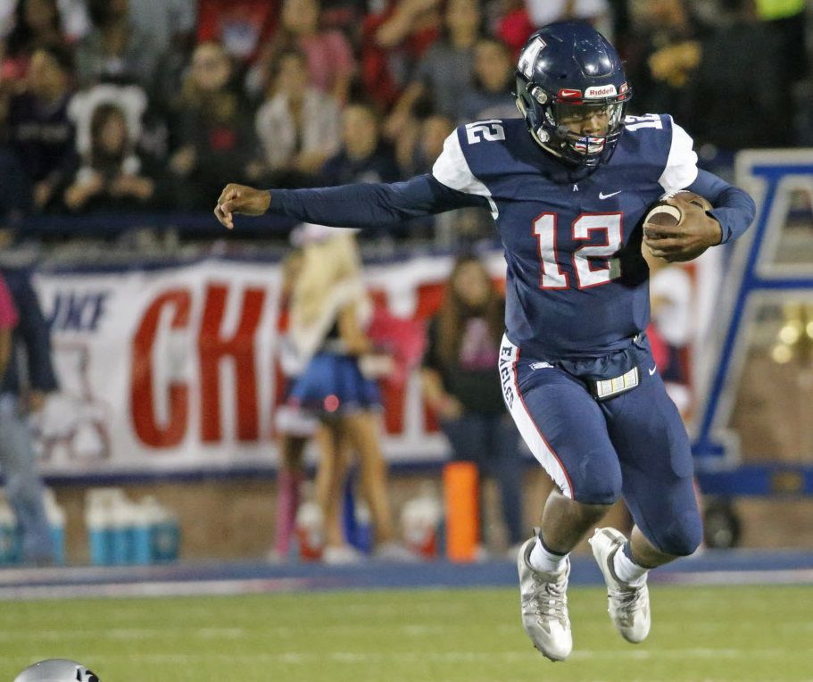 Allen quarterback Grant Tisdale leaps over lineman Will Sherman (72) on a second quarter run during the Denton Guyer High School Wildcats vs. the Allen High School Eagles football game at Eagle Stadium in Allen, Texas, on Friday, October 14, 2016. (Louis DeLuca/The Dallas Morning News)