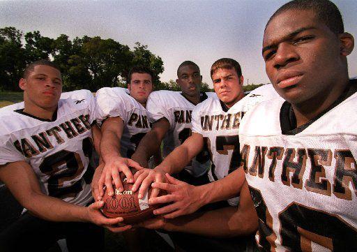 Plano East Senior High School top football defensive players; Rashad Coulter (21), left; Barton Hammitt (34), center left; Jason Dixon, (18), center; John Leake, (17), center right; and Anthony Jones, (88), right.