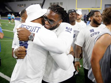 Dallas Cowboys quarterback Dak Prescott and linebacker Jaylon Smith congratulate one another after their Silverback #HotBoyz team won the Cowboys U high school football championship game in the Ford Center at The Star in Frisco, Texas, Thursday, June 6, 2019.  Cowboys players serve as coaches to select high school players during the football camp. The Dallas-Fort Worth student-athletes were selected by their respective high school football coaches and district athletic directors to attend the camp. The nearly 200 students represent 52 North Texas high schools from 12 different school districts.