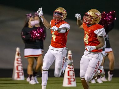 South Grand Prairie senior wide receiver Josh Nicholson (4) celebrates scoring a touchdown with senior wide receiver Deamikkio Nathan (8) during the first half of a high school football game against Mesquite at the Gopher-Warrior Bowl in Grand Prairie, Thursday, October 1, 2020.