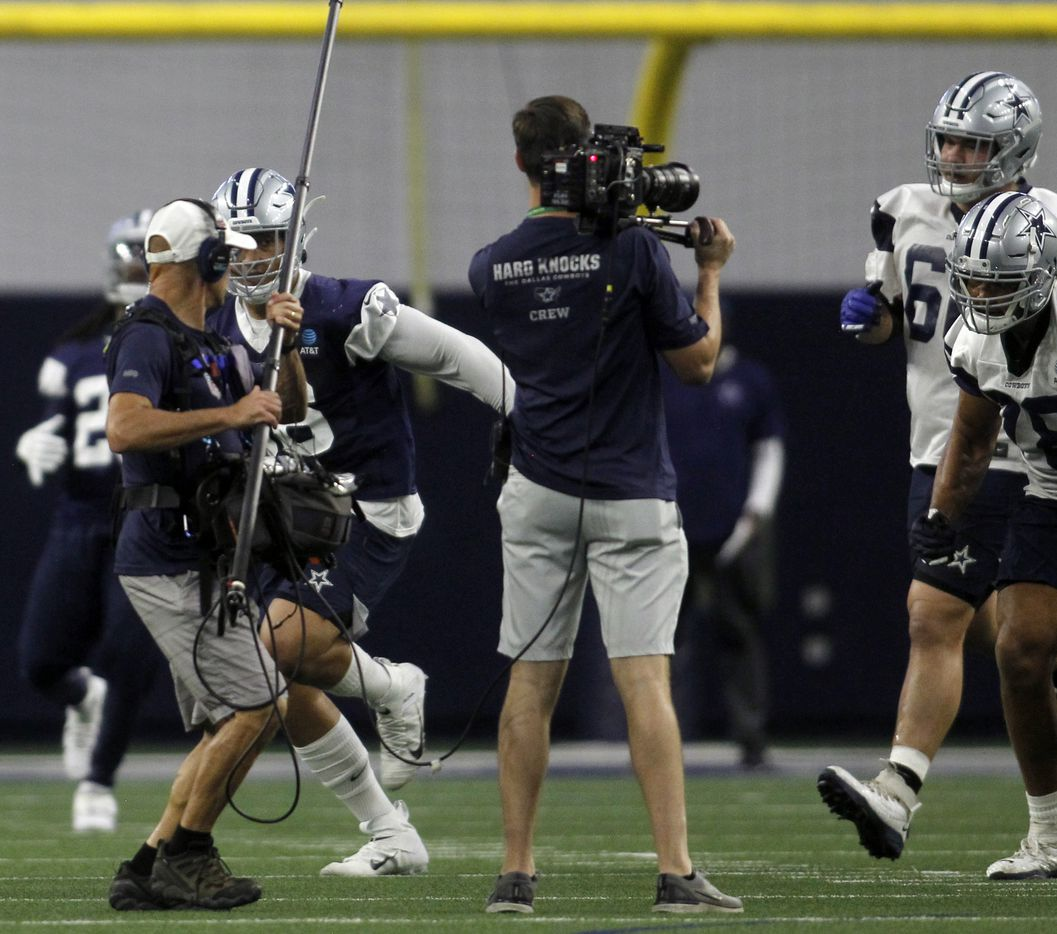 A Hard Knocks film crew film a team practice session. The Cowboys conducted their final public football practice session of training camp inside The Star at the Ford Center in Frisco on August 28, 2021. (Steve Hamm/ Special Contributor)