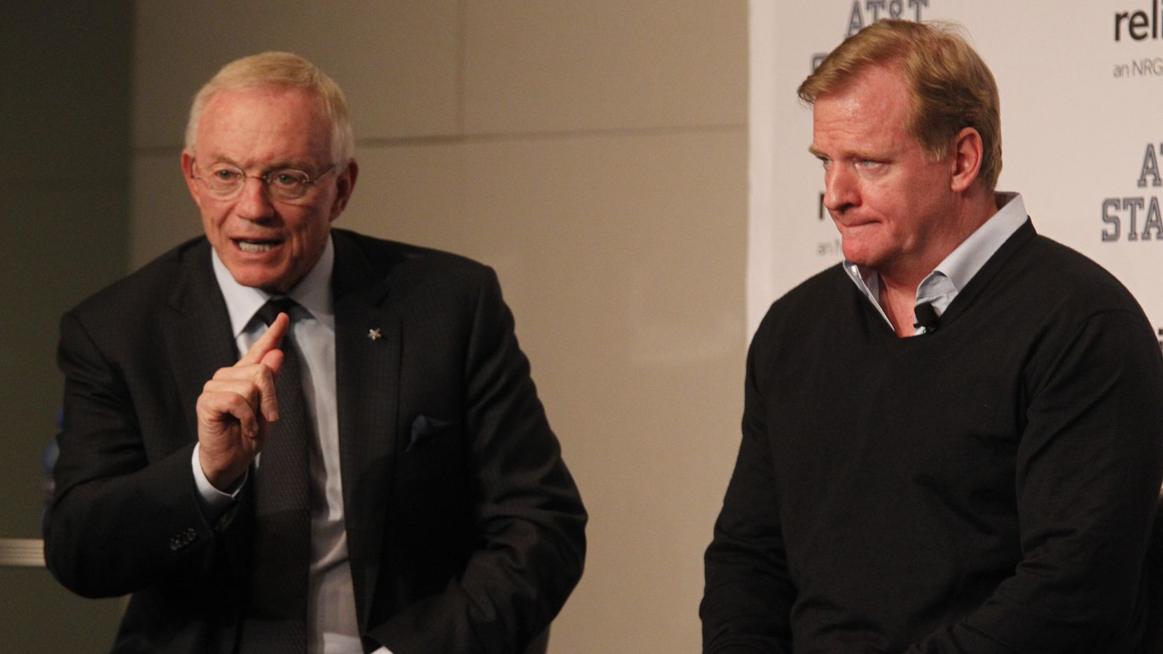 Dallas Cowboys owner Jerry Jones and NFL Commissioner Roger Goodell speak at a Fan Forum prior to the NFL football game in Arlington, Texas on October 13, 2013. (Michael Ainsworth/The Dallas Morning News)