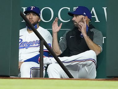 Texas Rangers manager Chris Woodward talks with catcher Jose Trevino in the dugout during the first inning against the Baltimore Orioles at Globe Life Field on Saturday, April 17, 2021.