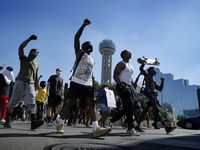 Protestors supporting Black Lives Matters rally march past Reunion Tower on their way to Dealey Plaza after a rally at Dallas City Hall, Wednesday, June 3, 2020.