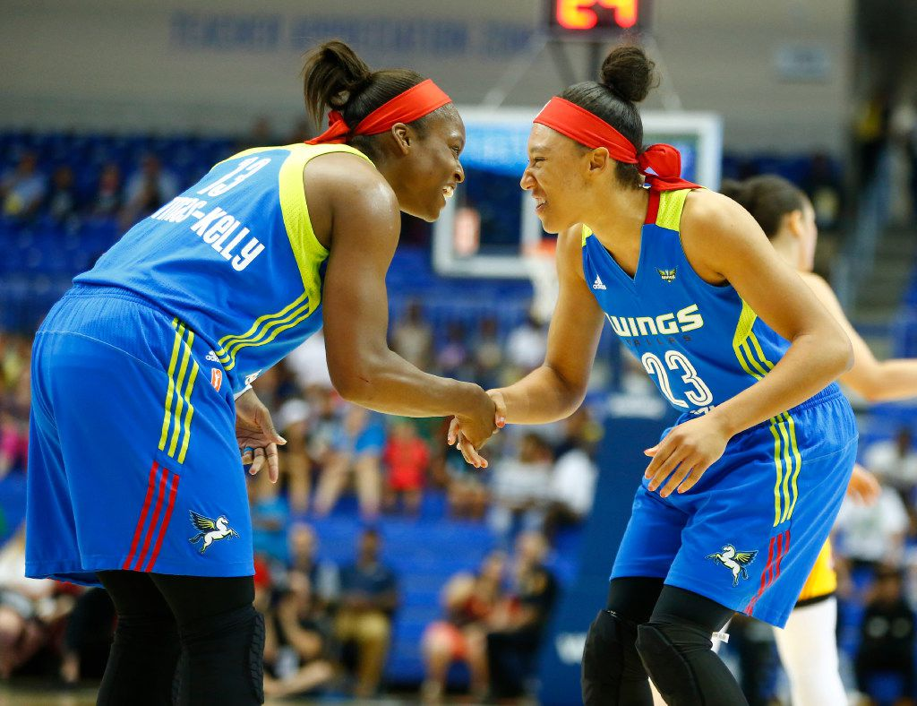 Dallas Wings guard Karima Christmas-Kelly (13) welcomes forward Aerial Powers (23) to the court in the first half of their game at UTA's College Park Center in Arlington, Texas on July 25, 2017.   (Nathan Hunsinger/The Dallas Morning News)