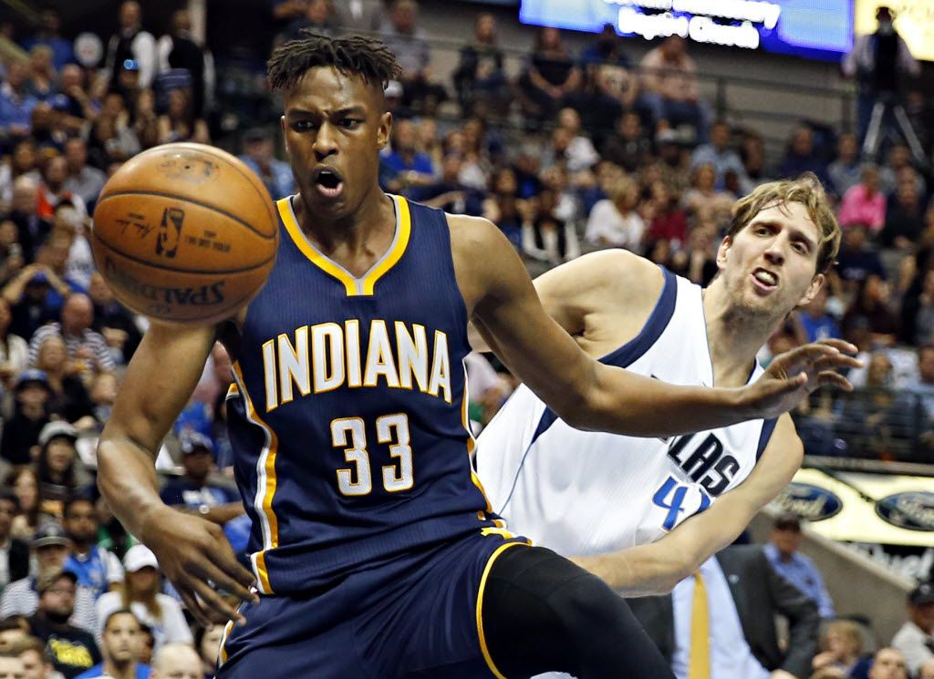 Dallas Mavericks forward David Lee (42) and Indiana Pacers forward Myles Turner battle for a rebound during the first half of their game Saturday, March 12, 2016 at the American Airlines Center in Dallas. (G.J. McCarthy/The Dallas Morning News)