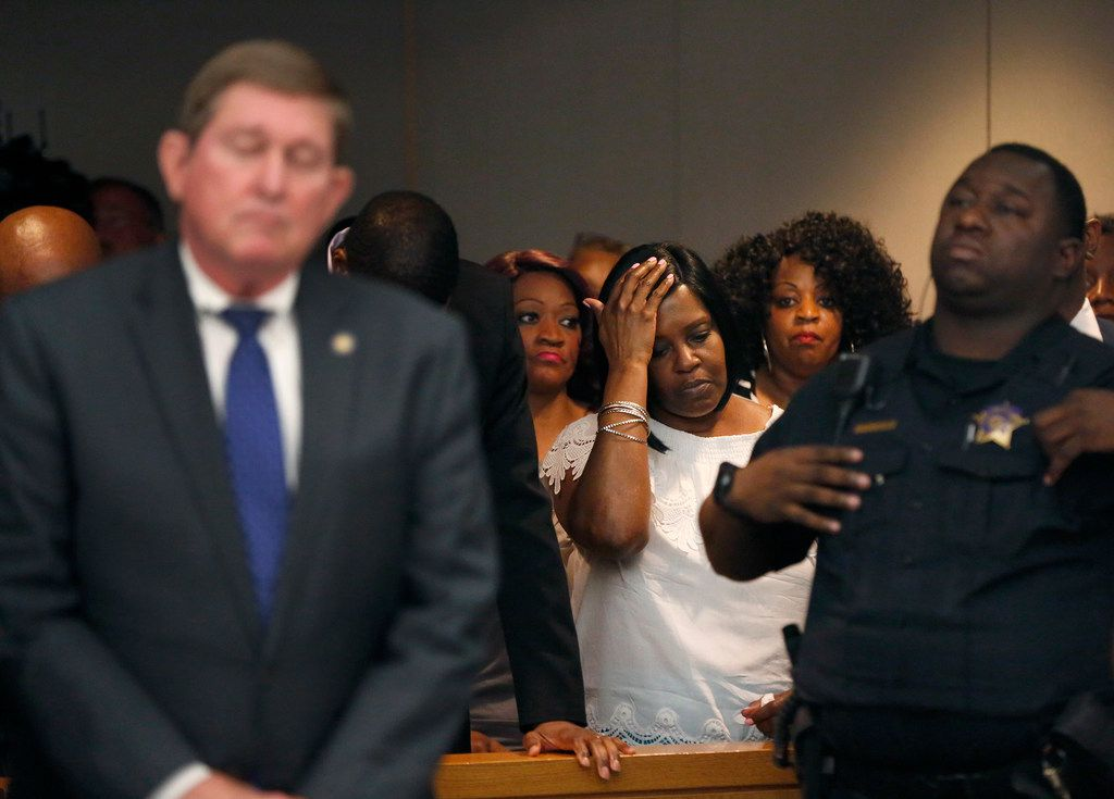 Karen Dancer, Jordan Edward's grandmother, holds her head after Tuesday's verdict in Roy Oliver's trial.