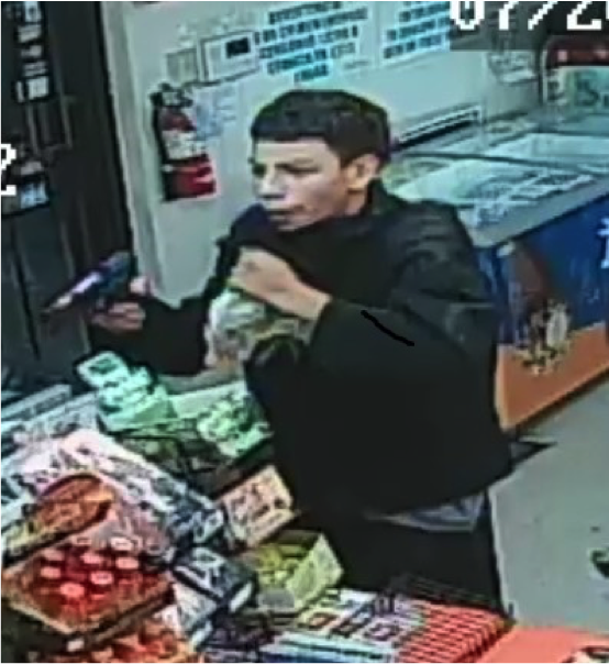 The first suspect lost his mask in the July 20 robbery.