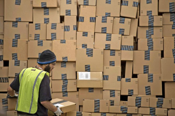 An employee loads a truck at an Amazon.com fulfillment center in Phoenix. In Texas, Amazon began collecting sales taxes in June 2012 with centers in Coppell, Haslet and Schertz.