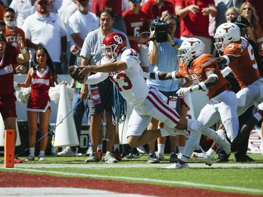 Oklahoma quarterback Caleb Williams (13) dives to score a touchdown during the first half of an NCAA college football game against Texas at the Cotton Bowl in Fair Park, Saturday, October 9, 2021.