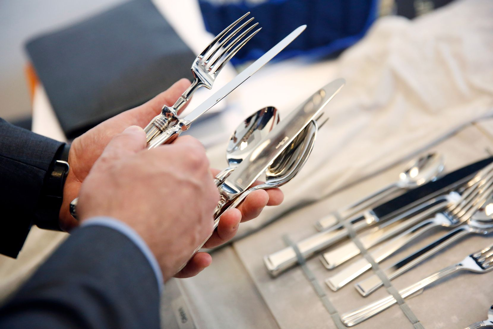 Anthony Cournia selects flatware to take to the French Room for consideration. After a month and a half of look, he and Michael Ehlert are zeroing on what they want. (Tom Fox/The Dallas Morning News)