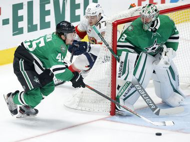 Dallas Stars defenseman Sami Vatanen (45) brings the puck from behind the net and goaltender Anton Khudobin (35) during the first period against the Florida Panthers at the American Airlines Center in Dallas, Tuesday, April 13, 2021. (Tom Fox/The Dallas Morning News)