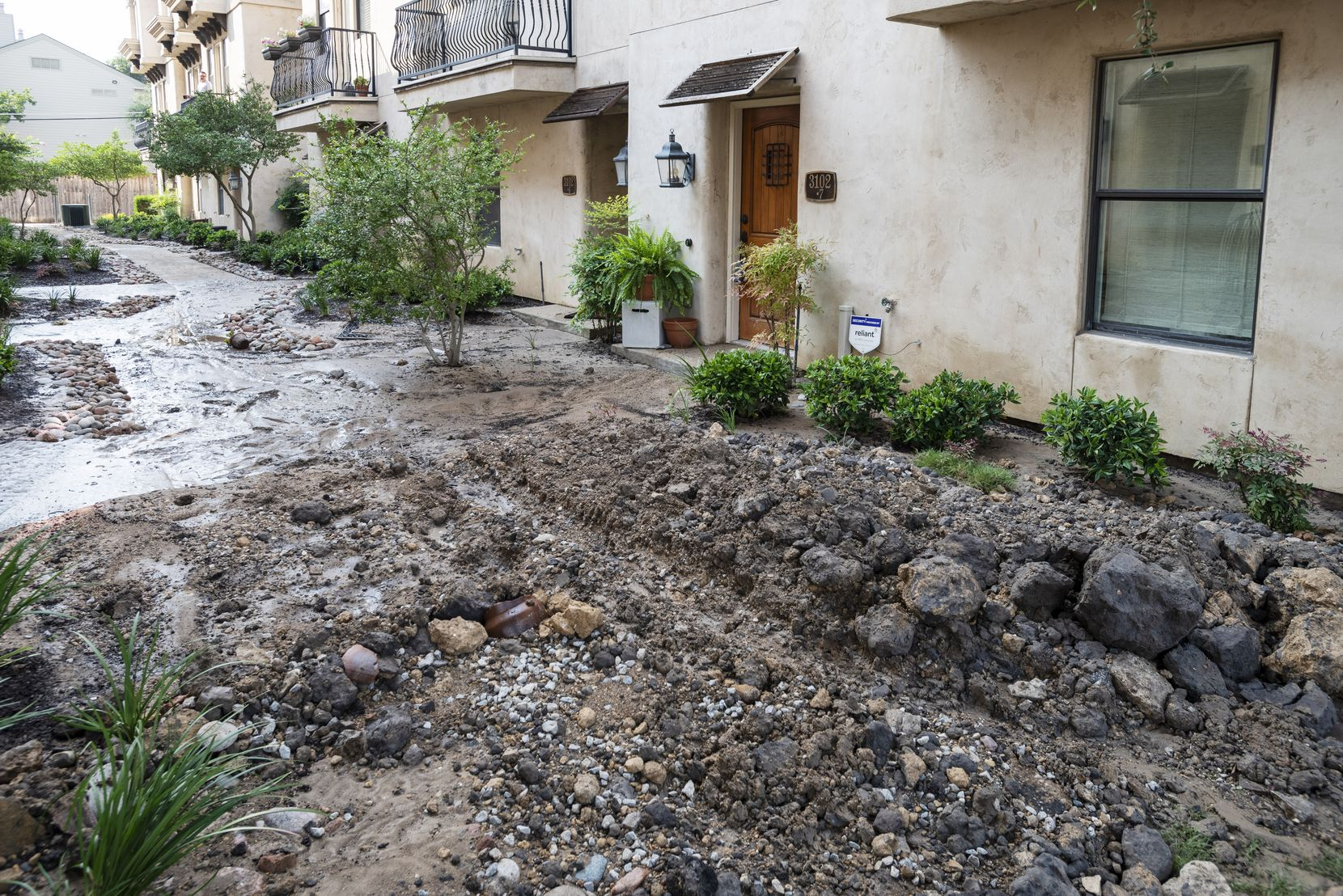 The flooding left a sludgy mix of mud and asphalt along parts of Ross, including a courtyard at the Veranda II apartments.