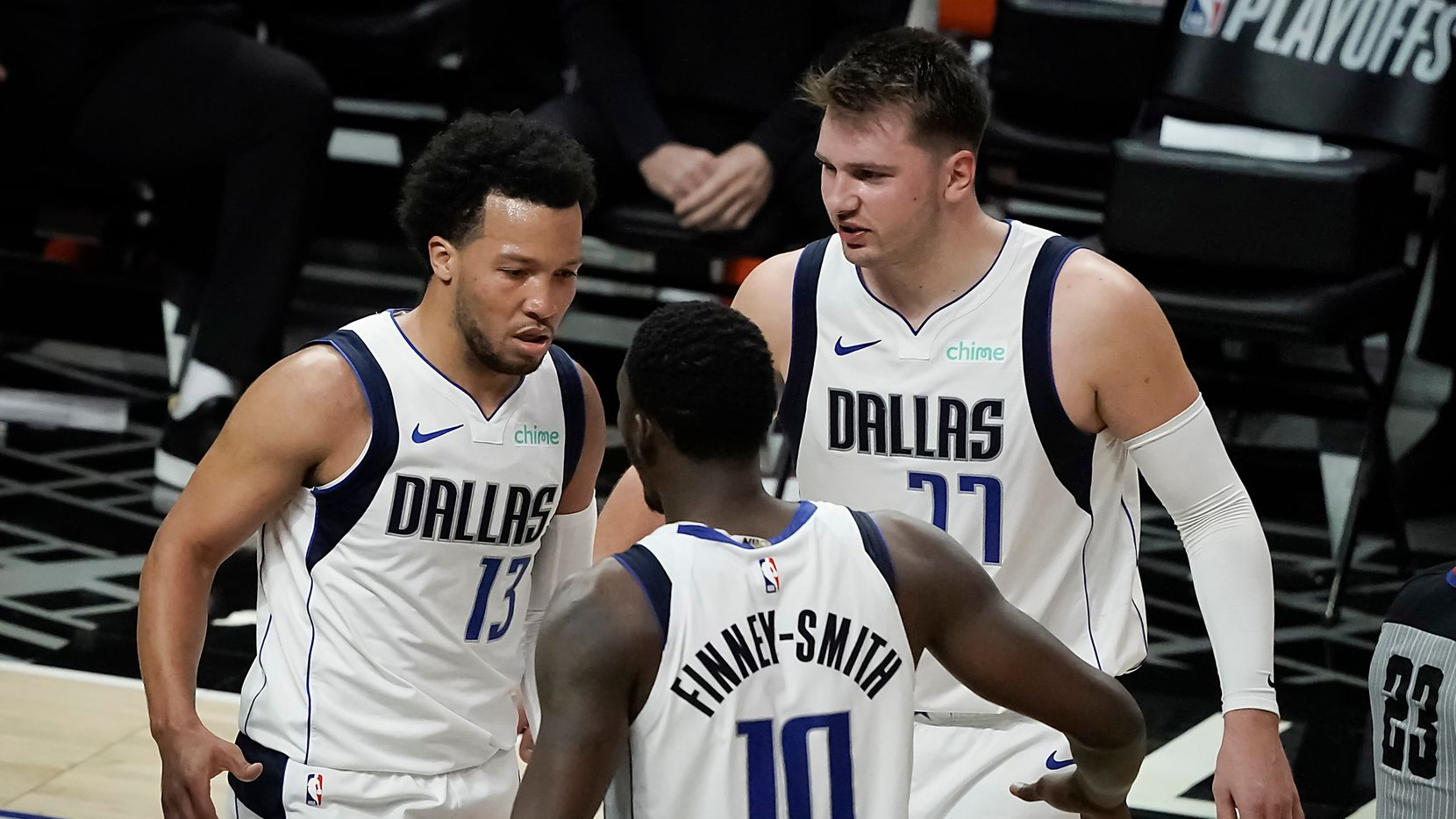Dallas Mavericks guard Jalen Brunson celebrates with forward Dorian Finney-Smith (10) and guard Luka Doncic (77) after scoring and picking up an and-one foul during the second half of an NBA playoff basketball game against the LA Clippers at Staples Center on Saturday, May 22, 2021, in Los Angeles. The Mavericks won the game 113-103.