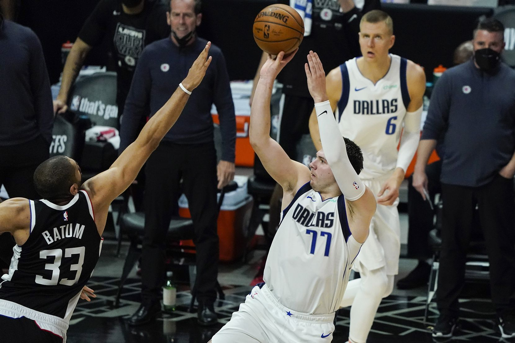 Dallas Mavericks guard Luka Doncic (77) shoots over LA Clippers forward Nicolas Batum (33) during the fourth quarter of an NBA playoff basketball game at the Staples Center on Wednesday, June 2, 2021, in Los Angeles. The Mavericks won the game 105-100. (Smiley N. Pool/The Dallas Morning News)